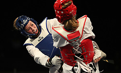 Great Britain's Jade Jones (left) on her way to winning her semi final match against Canada's Skylar Park, during day three of the WTF World Taekwondo Grand Prix 2018 at the Regional Arena, Manchester.