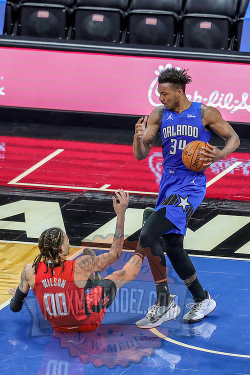 ORLANDO, FL - APRIL 18: D.J. Wilson #00 of the Houston Rockets falls after trying to steal the ball from Wendell Carter Jr. #34 of the Orlando Magic during the first half at Amway Center on April 18, 2021 in Orlando, Florida. NOTE TO USER: User expressly acknowledges and agrees that, by downloading and or using this photograph, User is consenting to the terms and conditions of the Getty Images License Agreement. (Photo by Alex Menendez/Getty Images)*** Local Caption *** D.J. Wilson; Wendell Carter Jr.