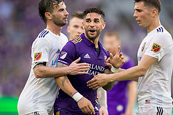May 6, 2018 - Orlando, FL, U.S. - ORLANDO, FL - MAY 06: Orlando City forward Dom Dwyer (14) has words with Real Salt Lake players during the soccer match between the Orlando City Lions and Real Salt Lake on May 6, 2018 at Orlando City Stadium in Orlando FL. Photo by Joe Petro/Icon Sportswire) (Credit Image: © Joe Petro/Icon SMI via ZUMA Press)
