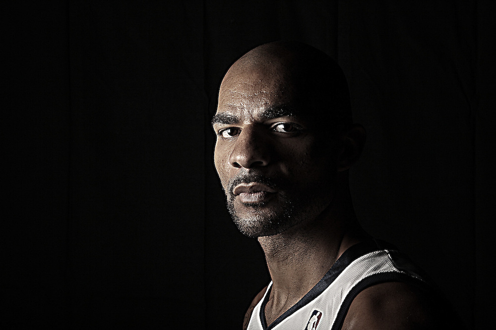 Jazz player Carlos Boozer, pose for photos for  special section cover in Salt Lake City, Utah, Monday, Oct. 12, 2009. (August Miller)