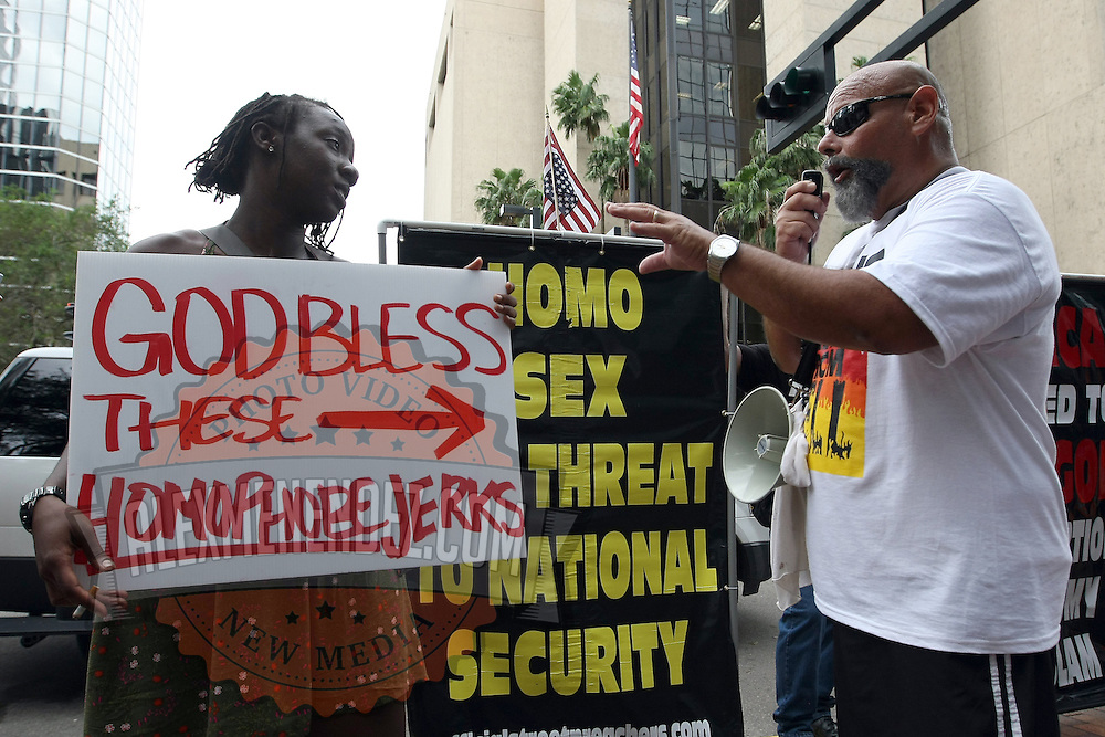 Chardonnay Singleton, a 24 year old student at the University of South Florida, stands her ground while arguing with Ruben Israel of the Bible Believers group during the Republican National Convention in Tampa, Fla. on Wednesday, August 29, 2012. (AP Photo/Alex Menendez)