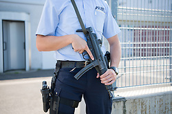 September 6, 2016 - Duesseldorf, North Rhine-Westphalia, Germany - A police officer holds a machine gun in front of the Higher Regional Court ahead of the trial against Salafi preacher Sven Lau in Duesseldorf,Germany, 06 September 2016. The federal prosecutor's office is charging Lau as a suspected supporter of the Syrian terrorist militia JAMWA (Army of Emigrants and Supporters). Photo:WOLFRAMKASTL/dpa (Credit Image: © Wolfram Kastl/DPA via ZUMA Press)