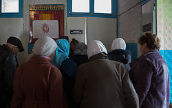 Patients at an MSF mobile clinic in the village of Gorodishe crowd around the consulting room door as they await their turn to see the doctor.