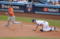 November 1, 2017 - Los Angeles, CA, United States - Dodgers Yu Darvish, #21, missed this tag on Astros Alex Bregman, #2, at first and allowed a run to score in the first inning of game 7 at the World Series at Dodger Stadium Wednesday, November 1, 2017. (Credit Image: © David Crane/Los Angeles Daily News via ZUMA Wire)