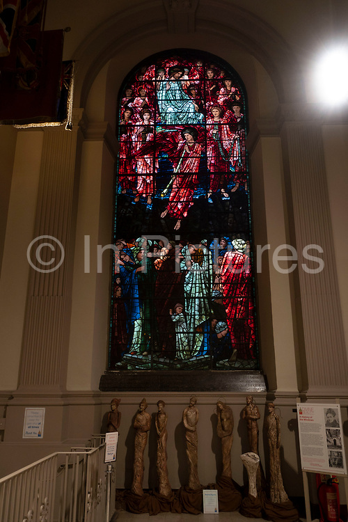 Stained glass windows in the interior of St Philips Cathedral in Birmingham, United Kingdom. The Cathedral Church of Saint Philip is the Church of England cathedral and the seat of the Bishop of Birmingham. Built as a parish church and consecrated in 1715, St Philips became the cathedral of the newly formed Diocese of Birmingham in 1905.