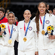 TOKYO, JAPAN August 8:  Skylar Diggins-Smith #5, Diana Taurasi #12 of the United States and Brittney Griner #15 of the United States with their gold medals after the Japan V USA basketball final for women at the Saitama Super Arena during the Tokyo 2020 Summer Olympic Games on August 8, 2021 in Tokyo, Japan. (Photo by Tim Clayton/Corbis via Getty Images)