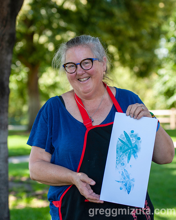 """Karen Brown. Wingtip Press, the City of Boise and Idaho Conservation League's  Print Boise River event at The Cabin, Boise, Idaho on July 13, 2019.<br />  <br /> Wingtip Press, the City of Boise ,and Idaho Conservation League partnered up to celebrate our love for the Boise River.<br /> <br /> This collaborative effort was directed by artist Amy Nack, founder of Wingtip Press and sponsored through a grant from Boise City Arts & History Department.<br /> <br /> PRINT BOISE RIVER participants carved fish, water images, birds and trees, adhered them to the bottom of flip flops and """"walked"""" their image along a 150' feet of paper. Each participant will become a public artist when the mural is displayed during Boise's First Thursday event in August 2019<br /> <br /> Lana Weber, ICL's Community Engagement Coordinator joined art makers to talk about the rivers contribution to our way of life in Boise."""