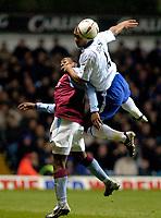 Photo: Richard Lane.<br />Aston Villa v Chelsea. Carling Cup. 17/12/2003.<br />Glen Johnson beats Darius Vassell in the air.