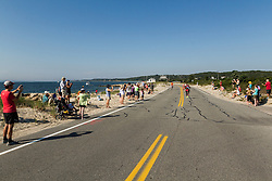 women's lead pack run along beach at Nobska Point Ledge