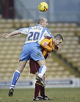 Photo: Aidan Ellis.<br /> Bradford City v Swindon Town. Coca Cola League 1. 11/02/2006.<br /> Swindon's Paul Smith gets a lift on Bradford's Steven Schumacher's back