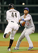 Sept 11, 2012; Houston, TX, USA; Houston Astros center fielder Justin Maxwell (44) collides with Chicago Cubs shortstop Starlin Castro (13) during the sixth inning at Minute Maid Park. Mandatory Credit: Thomas Campbell-US PRESSWIRE