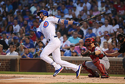 August 14, 2017 - Chicago, IL, USA - Chicago Cubs third baseman Kris Bryant (17) doubles against the Cincinnati Reds during the first inning of their game at Wrigley Field Monday Aug. 14, 2017 in Chicago. (Credit Image: © Nuccio Dinuzzo/TNS via ZUMA Wire)