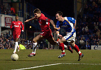 Photo: Daniel Hambury.<br />Portsmouth v Liverpool. The FA Cup. 29/01/2006.<br />Portsmouth's Andy O' Brien and Liverpool's Steven Gerrard chase the ball.