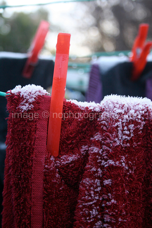 Frost covered laundry on the washing line in winter in Ireland