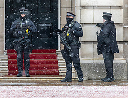 © Licensed to London News Pictures. 09/02/2021. London, UK. Police guarding Buckingham Palace in the snow this morning as Storm Darcy hits London and the South East with yet more snow and freezing temperatures today. The Met Office have issue numerous weather warnings for heavy snow and ice with disruption to travel, power cuts and possible stranded vehicles as the bad weather continues throughout the country.  Photo credit: Alex Lentati/LNP