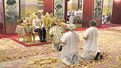 A handout photo made available by the Committee on Public Relations for the Coronation of King Rama X, shows Thai King Maha Vajiralongkorn Bodindradebayavarangkun (L) accompanied by Thai Queen Suthida (R), as they make the religious ceremony for the coronation inside the Royal palace in Bangkok, Thailand, 03 May 2019. The three-day ancient elaborate coronation ceremony of Thai King Rama X is scheduled for 04 to 06 May 2019. Editorial use only. Photo by Committee On Public Relations Fo Handout/ABACAPRESS.COM