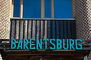 Sign for the Barentsburg Hotel, a Russian coal mining town in the Norwegian Archipelego of Svalbard. Once home to about 2000 miners and their families, less than 500 people now live here.