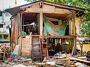 09 SEPTEMBER 2016 - BANGKOK, THAILAND: A partially demolished home in the Pom Mahakan Fort, one of 15 homes torn down by Bangkok officials over the weekend. Forty-four families still live in the Pom Mahakan Fort community. The city of Bangkok has given them provisional permission to stay, but city officials say the permission could be rescinded and the city go ahead with the evictions. The residents of the historic fort have barricaded most of the gates into the fort and are joined every day by community activists from around Bangkok who support their efforts to stay.           PHOTO BY JACK KURTZ