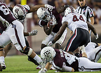 Texas A&M running back Keith Ford (7) shrugs off a tackle attempt by South Carolina defensive lineman Taylor Stallworth (90) during the fourth quarter of an NCAA college football game Saturday, Sept. 30, 2017, in College Station, Texas. (AP Photo/Sam Craft)