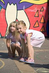 Nursery School girls playing in the school playground,