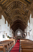 Church nave over wooden pews, altar and east window, hammer beam roof, Badingham, Suffolk, England, UK