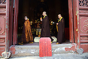 Buddhist monks perform an evening ceremony at Tanzhesi Temple.Situated in the Western Hills, this Buddhist temple lies 45km west of Beijing. The temple name means 'Dragon Pool and Mulberry Tree Temple', due to its proximity to the Dragon Pool and the trees growing in the surrounding hills.....
