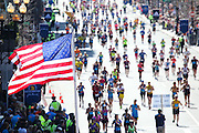 April 21, 2014 - Boston, Massachusetts, U.S. - <br /> <br /> Boston Marathon 2014<br /> <br /> Tens of thousands of runners cross the finish line of the 2014 Boston Marathon in Boston, Massachusetts. Two runners embrace after finishing the race. <br /> ©Exclusivepix