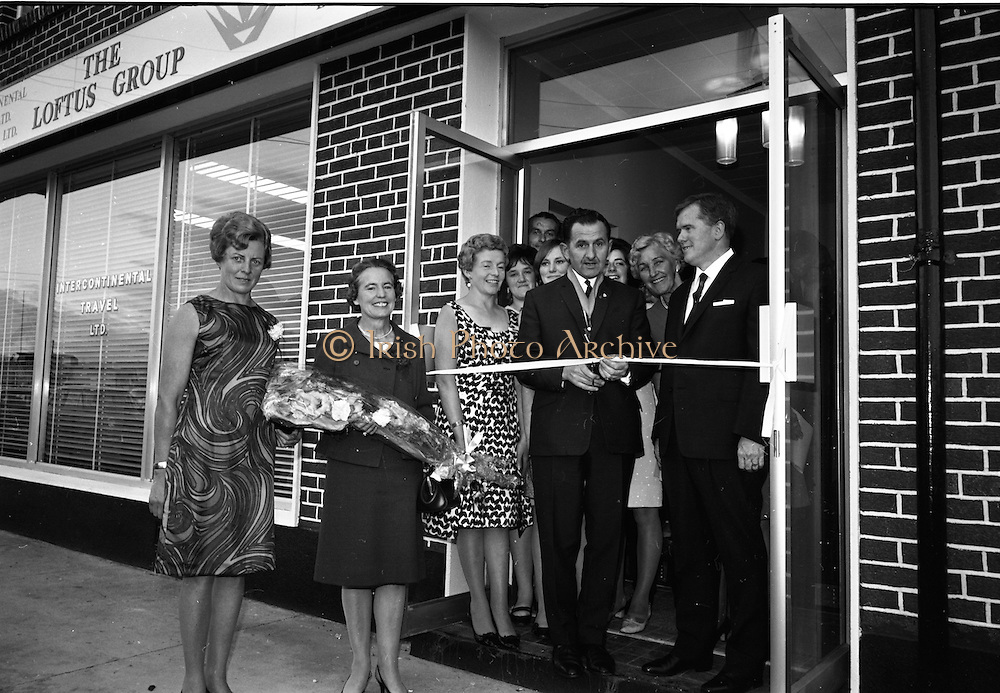 19/07/1967<br /> 07/19/1967<br /> 19 July 1967<br /> Opening of Intercontinental Travel Ltd. at Crumlin Cross, Dublin. The company, an associate company of the Loftus group of Companies was the first Irish Travel Agency to be opened in the outer suburbs of Dublin. Photo shows Mr. Oliver Flanagan, T.D., President of the Irish Auctioneers Association cutting the tape to open the new premises. Also included are Mrs Flanagan, Mr and Mrs J.J. Lotus, Directors of the Loftus Group and employees of the group.