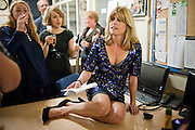 RACHEL JOHNSON, ON A DESK IN THE LADY'S OFFICE. Rachel's Johnson's 'A Diary of the Lady'book launch at The Lady's offices. Covent Garden. London. 30 September 2010. -DO NOT ARCHIVE-© Copyright Photograph by Dafydd Jones. 248 Clapham Rd. London SW9 0PZ. Tel 0207 820 0771. www.dafjones.com.
