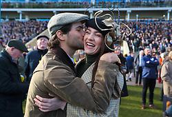 Racegoers celebrate a win during St Patrick's Thursday of the 2018 Cheltenham Festival at Cheltenham Racecourse.