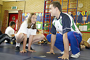 Olympic Gymnast, Danile Keeating visits his old school of Daneholme Juniors in Corby...pictured with Daniel, learning the best bunny hop position is 10 yr old, Emma Kibble