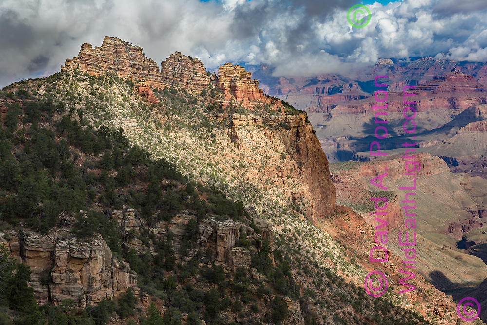 Morning light on the Sinking Ship formation along the South Rim of the Grand Canyon, with clouds clinging to the North Rim, © David A. Ponton