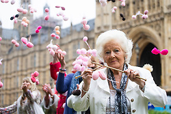 Edna Cosnett, 93, from New Malden is joined outside parliament by 'knitting nans' from across the UK supporting Fathers4Justice. The grandmothers are knitting 650 pairs of balls, enough for every MP, to campaign for separated fathers to have greater access to their children. Edna has not seen her great grandchild for two years. London, June 04 2018.