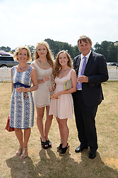 Left to right, JUDITH PAGE, NATASHA PAGE, GEORGINA HENDERSON and IAN FITCHEW at the Veuve Clicquot Gold Cup, Cowdray Park, Midhurst, West Sussex on 21st July 2013.