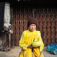 A Buddhist nun with her alms bowl at the Phú Nhuận vegetable market in Ho Chi Minh City, also known as Saigon, Vietnam.