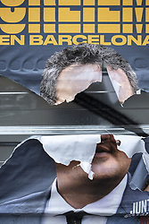 May 25, 2019 - Barcelona, Catalonia, Spain - A poster of electoral propaganda of the pro-independence candidate currently in prison Joaquim Forn is seen half-baked..Election posters are seen broken, manipulated or covered by other posters during the last week of the election campaign. (Credit Image: © Paco Freire/SOPA Images via ZUMA Wire)