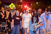 """Oct. 30, 2009 -- PHOENIX, AZ: Zombies cross a street in Phoenix Friday during the Zombie Walk. About 200 people participated in the first """"Zombie Walk"""" in Phoenix, AZ, Friday night. The Zombies walked through downtown Phoenix """"attacking"""" willing victims and mixing with folks going to the theatre and downtown sports venues.  Photo by Jack Kurtz"""