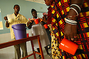 Health workers distribute milk to mothers at the therapeutic feeding center of the Magbenthe hospital in Makeni, Sierra Leone on Thursday February 26, 2009. UNICEF sponsored some of the construction of the hospital facilities, and also provides high-protein biscuits and milk as part of a joint effort with the World Food Programme..