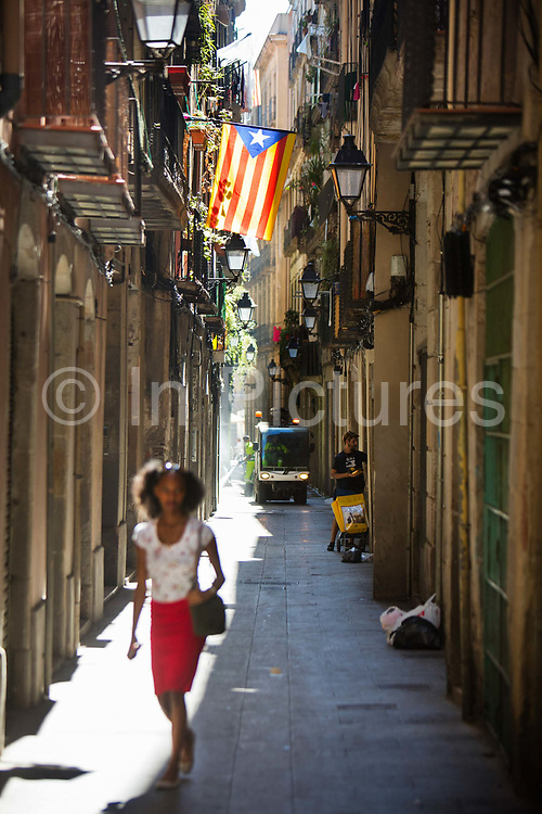 Catalan flag in the backsteets of the gothic quarter, Barcelona, Spain.