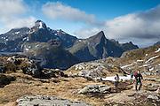 Hiking near Munkebu huts, above Sørvågen in the Lofoten Islands of Norway