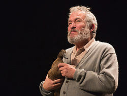 "© Licensed to London News Pictures. 24/10/2014. London, England. Pictured: Actor Richard Piper as Ekdal with a Duck called Deirdre. Belvoir Theatre from Sydney, Australia, present ""The Wild Duck"" by Simon Stone and Chris Ryan after Henrik Ibsen from 23 October - 1 November 2014 at the Barbican Theatre, London. The play is part of the International Ibsen Season and is directed by Simon Stone. Photo credit: Bettina Strenske/LNP"