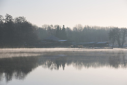 Harefield, UK. 19 January, 2020. Early morning mist lies across a lake in Colne Valley Regional Park across which a 3.4 km-long viaduct would be constructed should plans for the HS2 high-speed rail link be approved. Bailiffs acting for HS2 have been evicting Save the Colne Valley and Stop HS2 activists from the Colne Valley wildlife protection camp alongside the lake for the past week and a half. 108 ancient woodlands are set to be destroyed by the high-speed rail link.