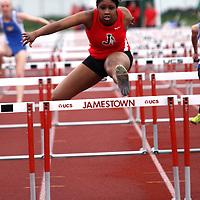 Jamestown's Cienna Simon en route to winning the 100 meters hurdles during track action at Strider Field in  Jamestown NY 5-1-12 photo by Mark L. Anderson
