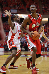 """31 January 2009: Dinma Odiakosa moves in to stop the advance to the bucket by David Collins. The Illinois State University Redbirds join the Bradley Braves in a tie for 2nd place in """"The Valley"""" with a 69-65 win on Doug Collins Court inside Redbird Arena on the campus of Illinois State University in Normal Illinois"""