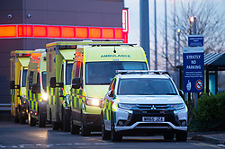 © Licensed to London News Pictures 30/12/2020.        Dartford, UK. A line of emergency vehicles. Ambulances coming and going at Darent Valley Hospital in Dartford, Kent. The NHS is overwhelmed with Covid-19 patients across the country with some ambulances waiting outside hospitals for hours with patients onboard. Photo credit:Grant Falvey/LNP