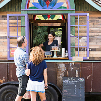 Chantal Bérot, the owner of Le Bon Cafe, chats with customers from her mobile coffee shop at the River Arts District Farmers Market which is held Wednesdays at 175 Clingman Avenue (next to All Souls Pizza) in the River Arts District of Asheville, North Carolina.