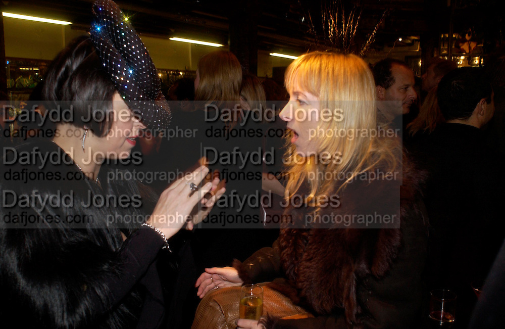 isabella Blow and Trino Verkade, Party hosted by Isabella Blow in honour of Shaun Leane to celebrate his jewelry collection. Liberty's. London. 8 December 2004. ONE TIME USE ONLY - DO NOT ARCHIVE  © Copyright Photograph by Dafydd Jones 66 Stockwell Park Rd. London SW9 0DA Tel 020 7733 0108 www.dafjones.com