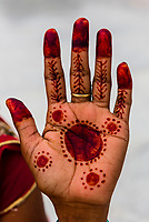 Woman's hand with mehndi (Henna dyed body art), Vrindavan, India.