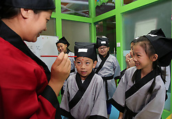 August 28, 2017 - Nanton, Nanton, China - Nantong, CHINA-28th August 2017: (EDITORIAL USE ONLY. CHINA OUT) ..Kids attend enlightment ceremony in Nantong, east China's Jiangsu Province, August 28th, 2017. (Credit Image: © SIPA Asia via ZUMA Wire)