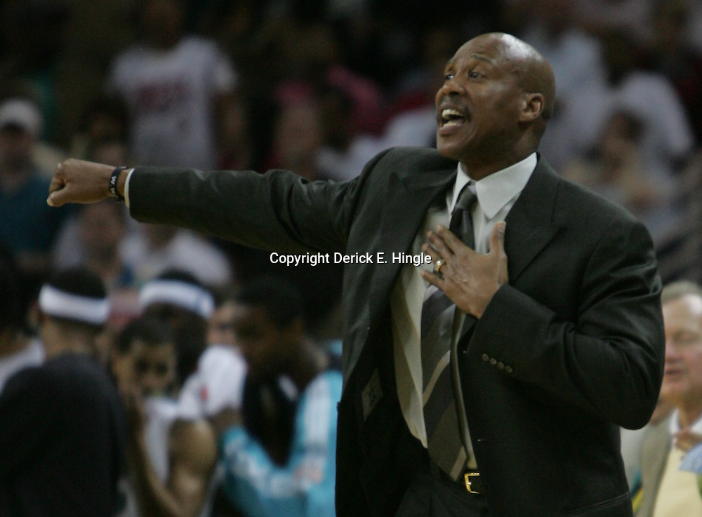 New Orleans Hornets head coach Byron Scott yells in from the bench against the Boston Celtics in the third quarter of their NBA game on March 22, 2008 at the New Orleans Arena in New Orleans, Louisiana. The New Orleans Hornets defeated the Boston Celtics 113-106.
